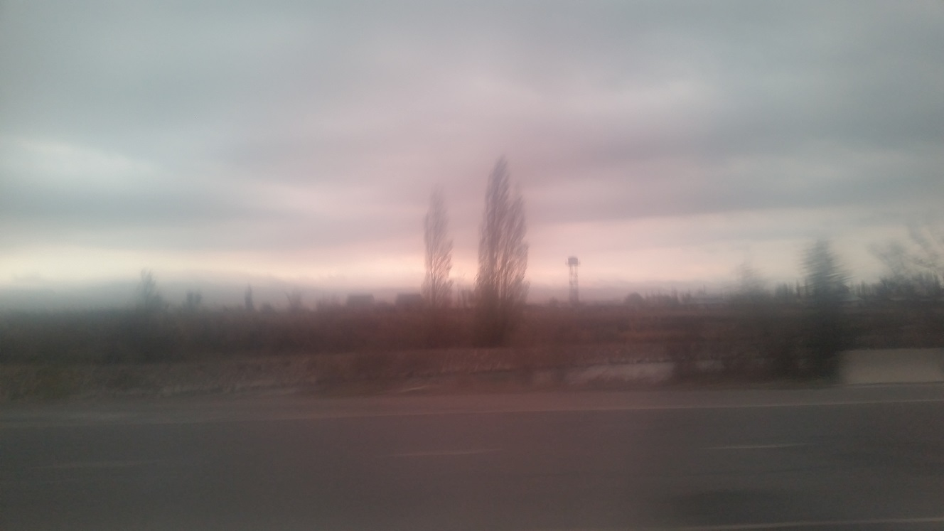 Hey it's Kazakhstan! Through the foggy marshrutka window. You can see a lookout tower