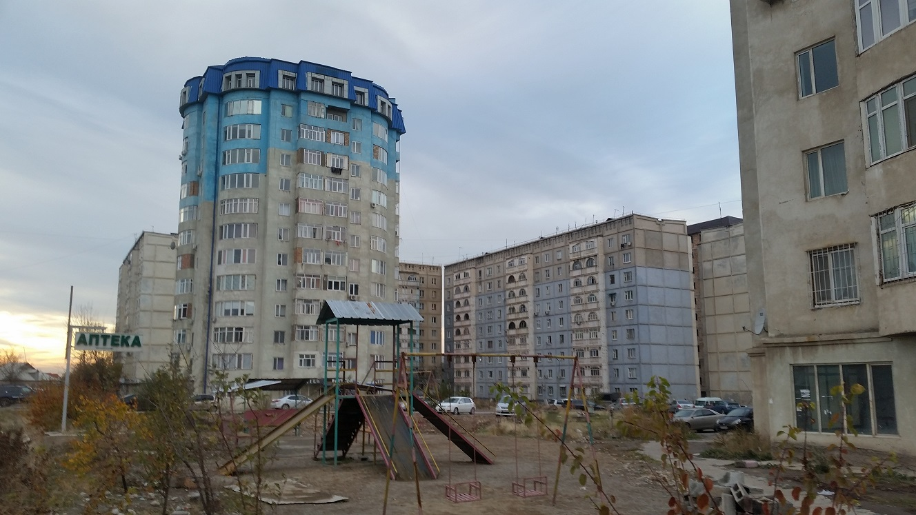 Soviet apartments with playground. Did they run out of blue paint?