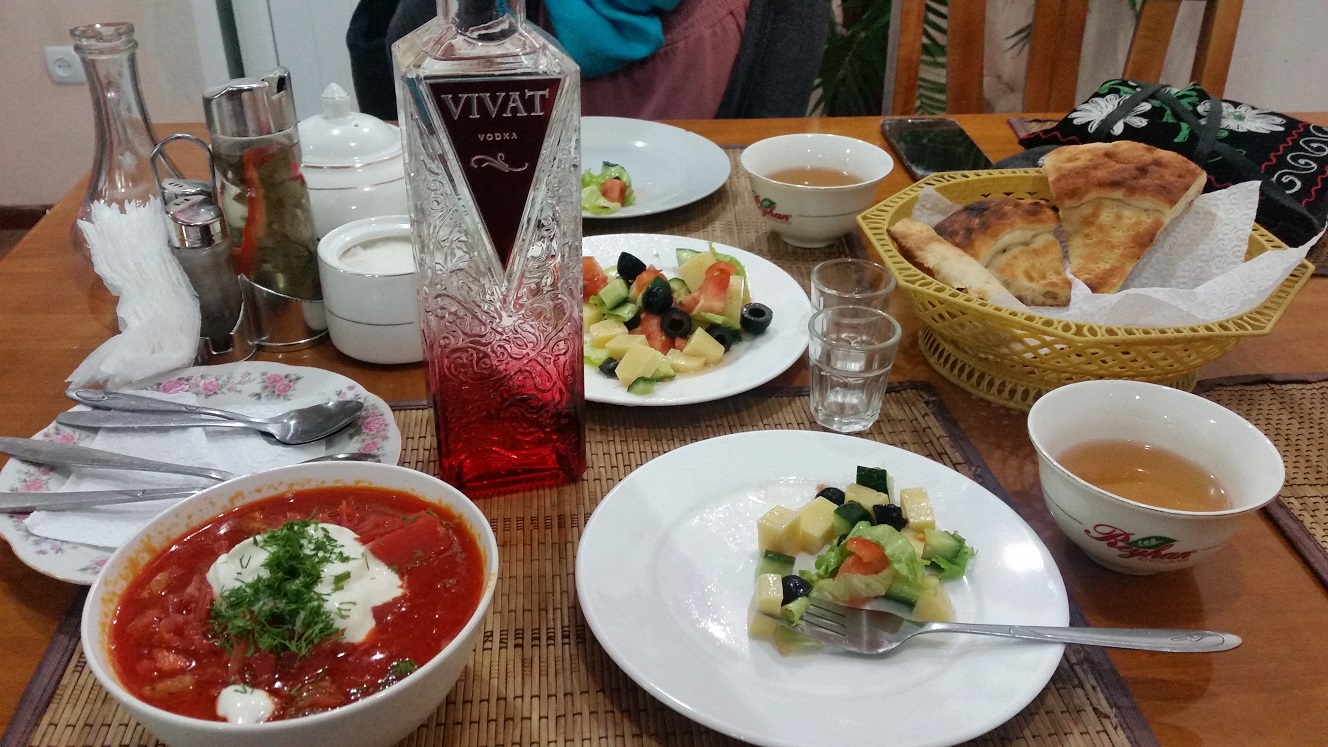 Borscht, salad, bread, vodka. We had to finish the whole bottle because it would have gone bad otherwise. Pilaf had not yet arrived.
